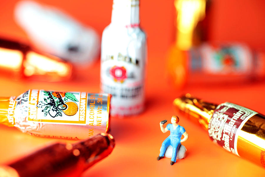 Drinking Photograph - Drinking Among Liquor Filled Chocolate Bottles by Paul Ge