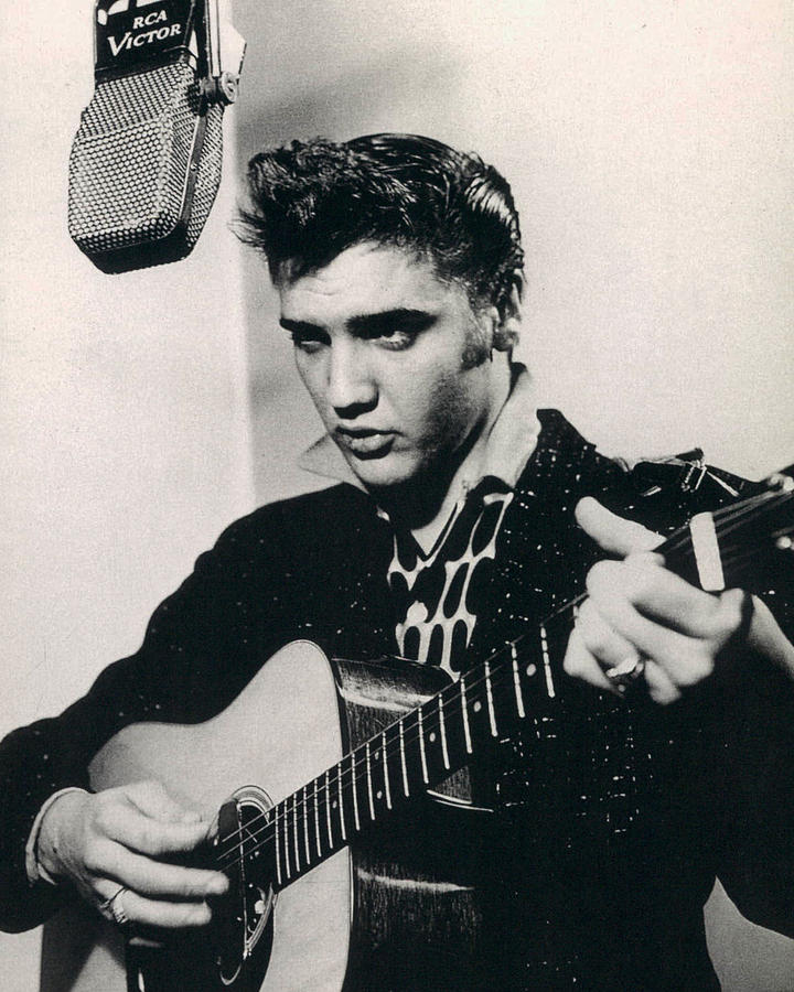 Elvis Presley Plays And Sings Into Old Microphone Photograph