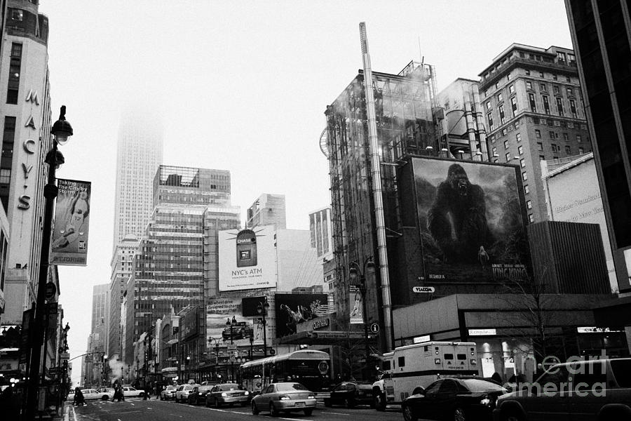 empire state building shrouded in mist from west 34th Street and 7th Avenue King Kong movie poster Photograph  - empire state building shrouded in mist from west 34th Street and 7th Avenue King Kong movie poster Fine Art Print