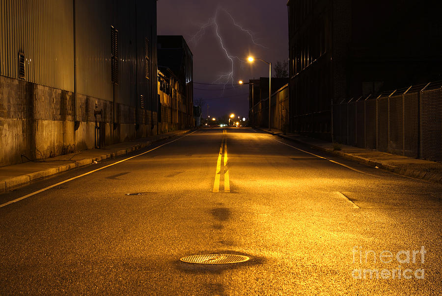 Empty City Street At Night With Lighting Strike Photograph