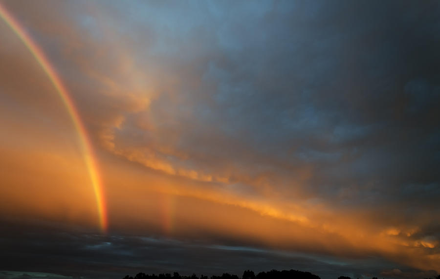 Ethereal Clouds And Rainbow Photograph