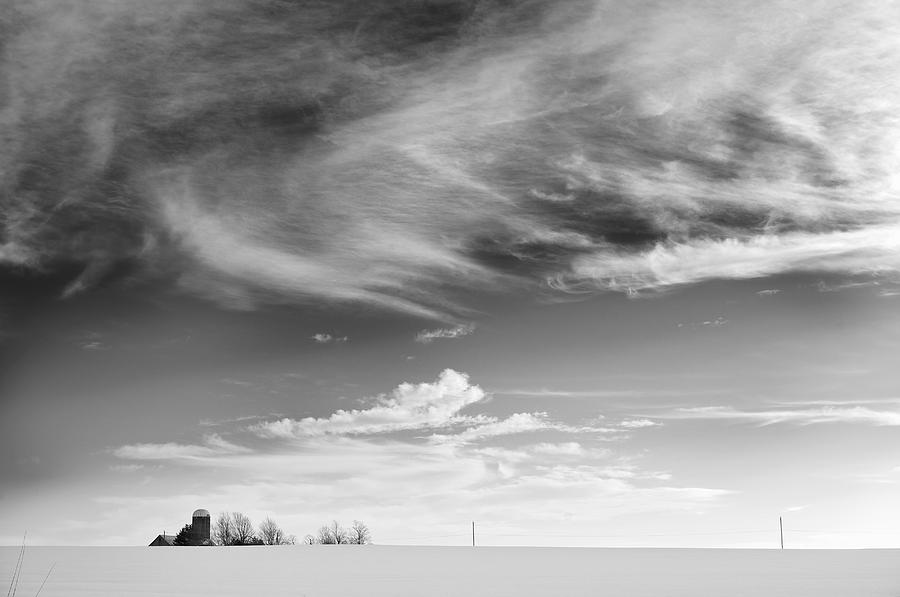Farm In The Distance In A Snowy Field Photograph