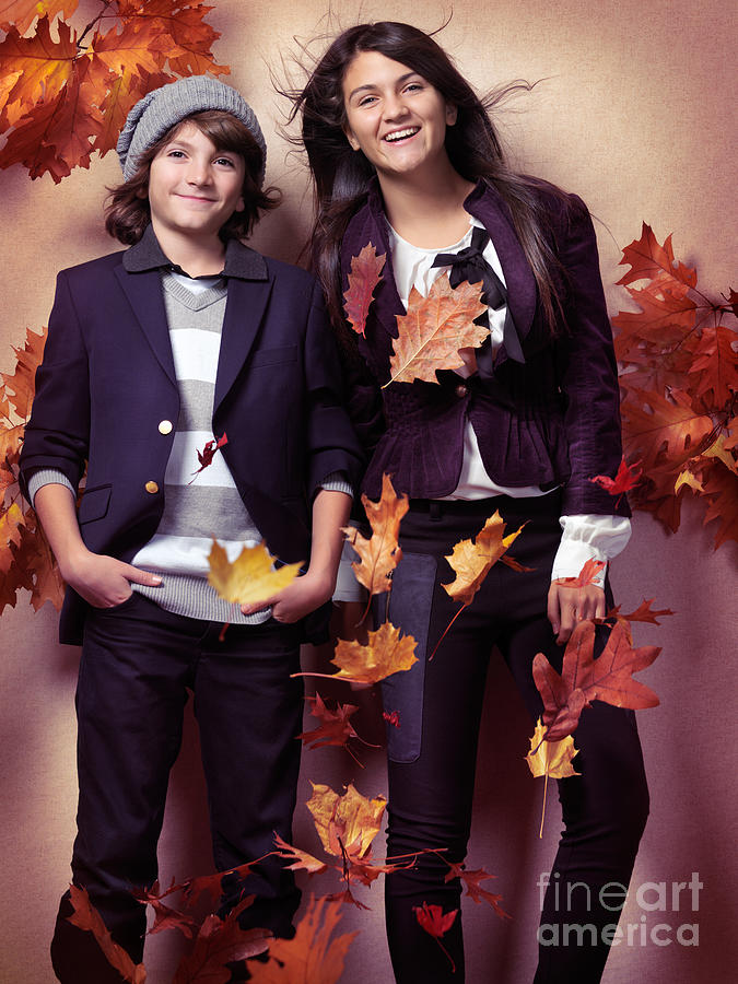 Fashionably Dressed Boy And Teenage Girl Fall Fashion Photograph