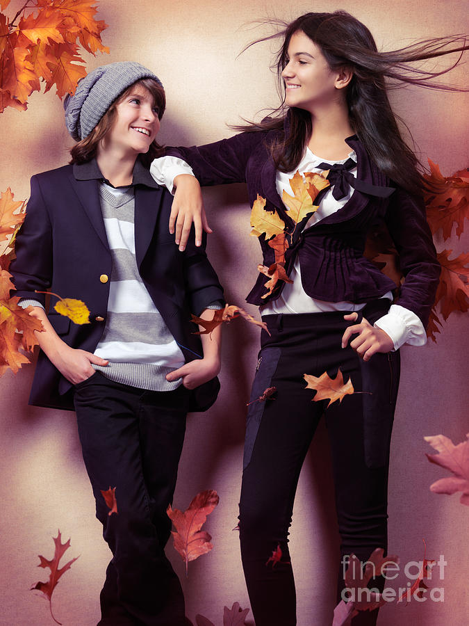 Children Photograph - Fashionably Dressed Boy And Teenage Girl Under Falling Autumn Le by Oleksiy Maksymenko