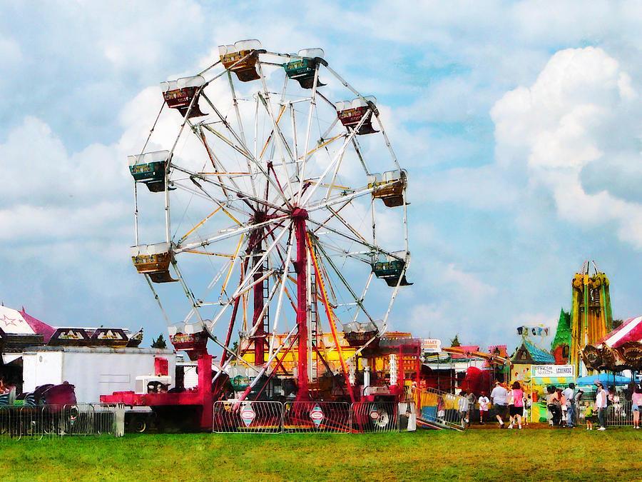 Ferris Wheel Against Blue Sky Photograph