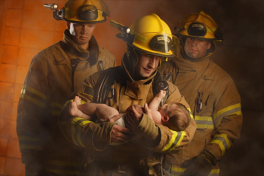 Fire Fighters Rescuing A Baby Photograph  - Fire Fighters Rescuing A Baby Fine Art Print