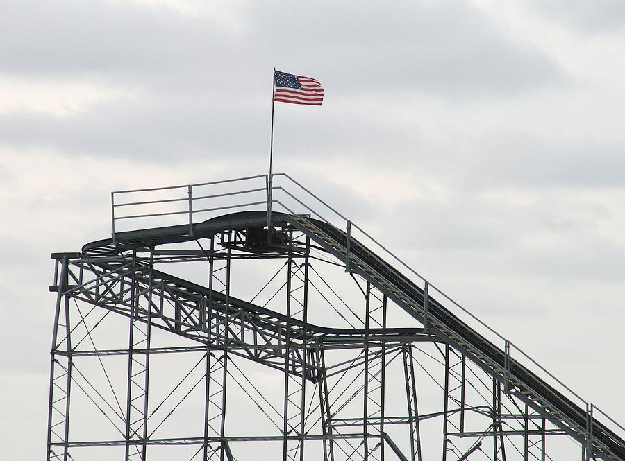 Flag Mounted On Seaside Heights Roller Coaster Photograph
