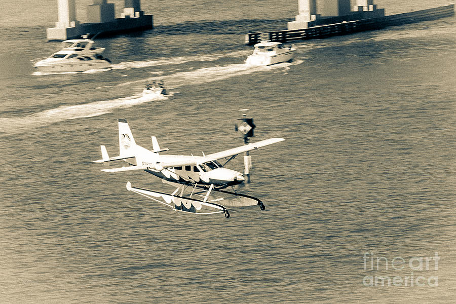 Seaplane Photograph - Flight- Landing In The Bay by Rene Triay Photography
