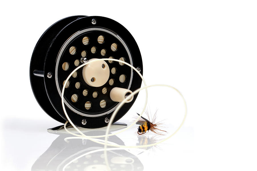 Black Photograph - Fly Fishing Reel With Fly by Tom Mc Nemar