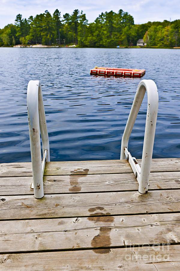 Footprints Photograph - Footprints On Dock At Summer Lake by Elena Elisseeva