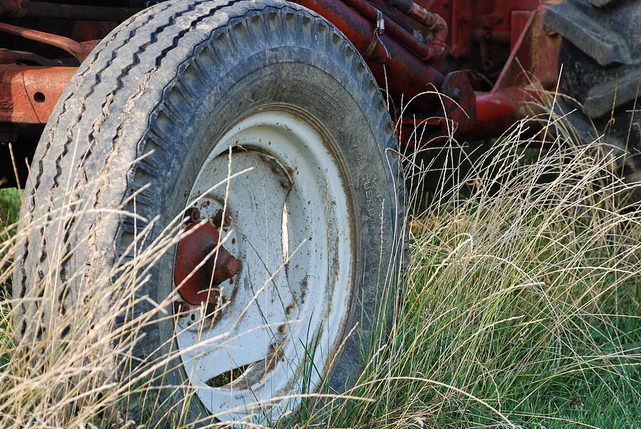 Ford Photograph - Ford Tractor Tire by Jennifer Ancker