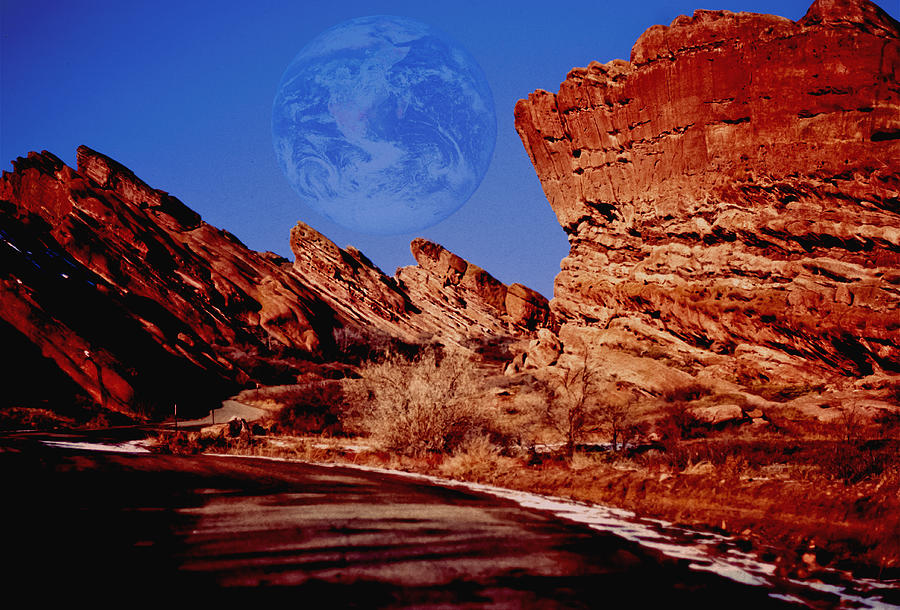 Full Earth Over Red Rocks Photograph