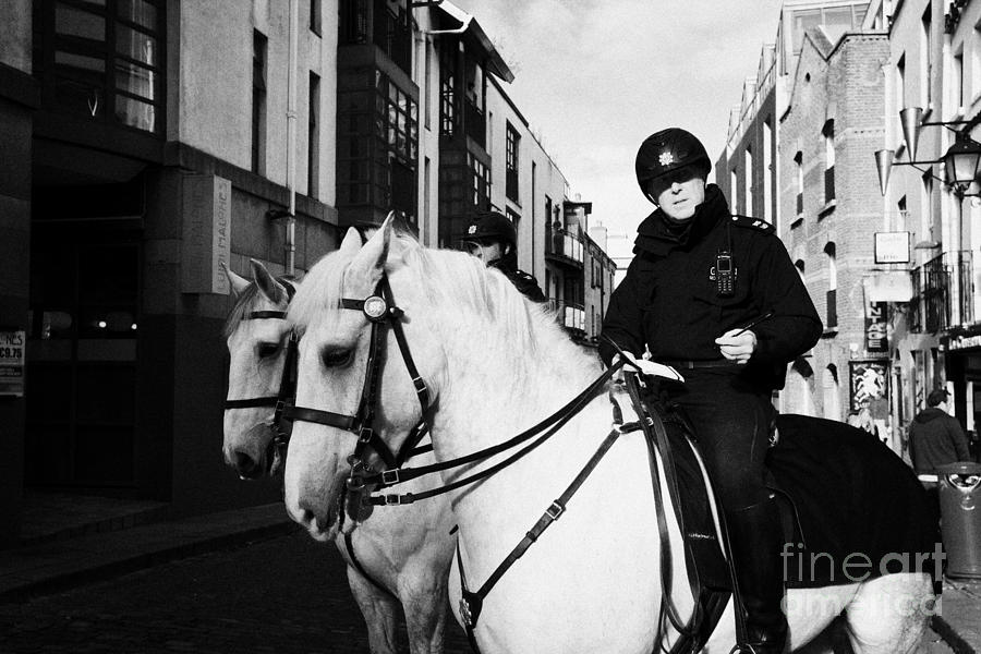 Garda Siochana Mounted Police On Horseback In Temple Bar Dublin Republic Of Ireland Photograph  - Garda Siochana Mounted Police On Horseback In Temple Bar Dublin Republic Of Ireland Fine Art Print