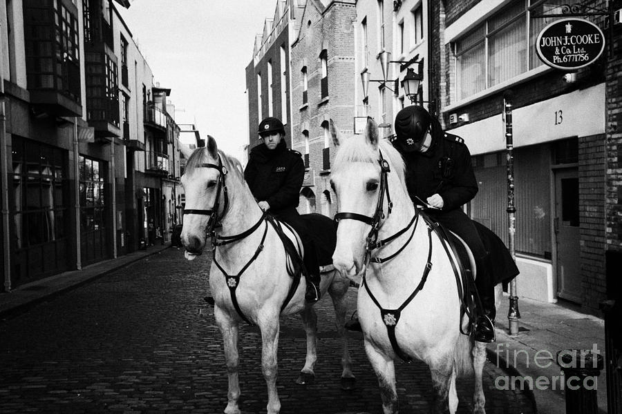 Garda Siochana Mounted Police On Horseback Taking Notes In Temple Bar Dublin Republic Of Ireland Photograph  - Garda Siochana Mounted Police On Horseback Taking Notes In Temple Bar Dublin Republic Of Ireland Fine Art Print