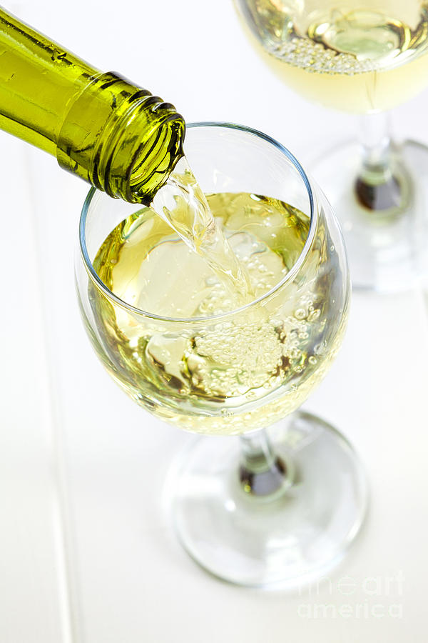 Glass Of White Wine Being Poured Photograph
