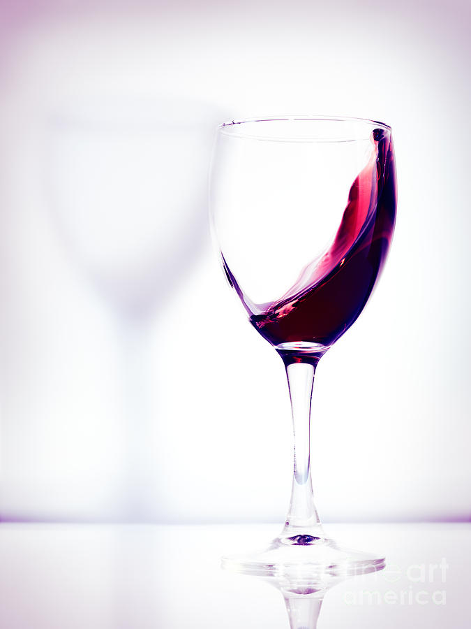 Glass With Red Wine Splash Photograph by Oleksiy Maksymenko