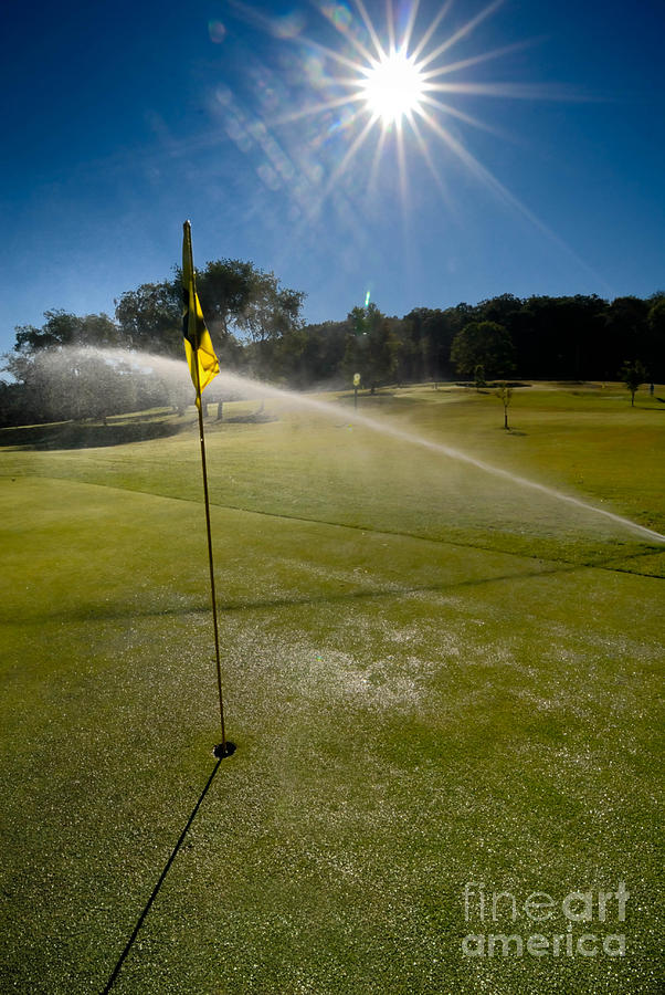 Golf Course Sprinkler On Sunny Day Photograph