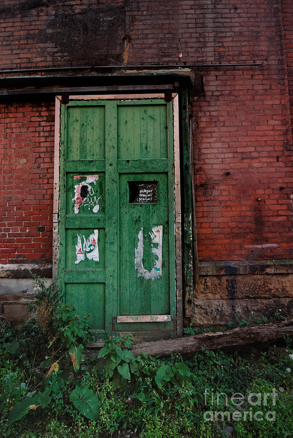 Green Door On Red Brick Wall Photograph