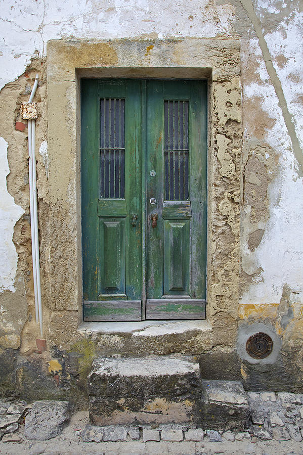 Green Wood Door With Hand Carved Stone In The Medieval Village Of Obidos Photograph