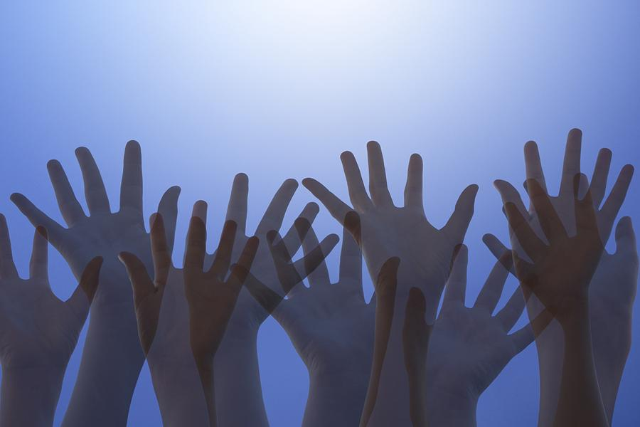 Hands Raised In Worship Photograph