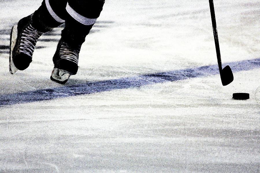 Hockey Photograph - He Skates by Karol Livote