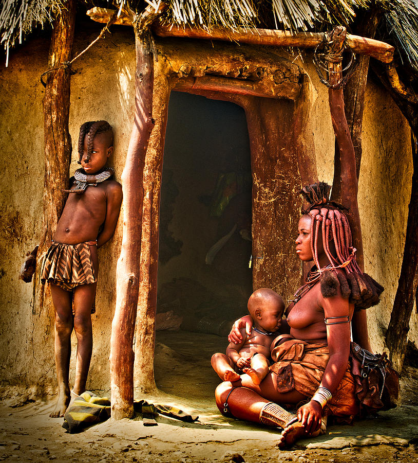 Himba Family By The Door Of Their Clay Hut Photograph  - Himba Family By The Door Of Their Clay Hut Fine Art Print