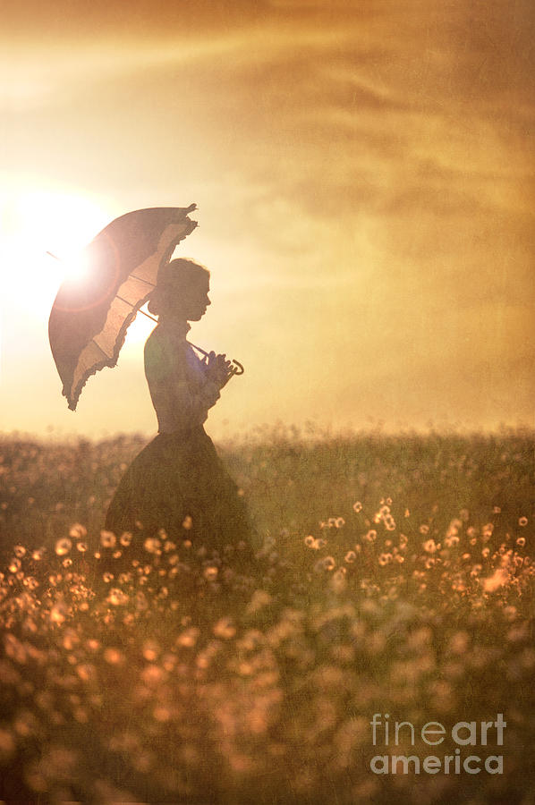 Historical Woman With Parasol In A Meadow At Sunset Photograph