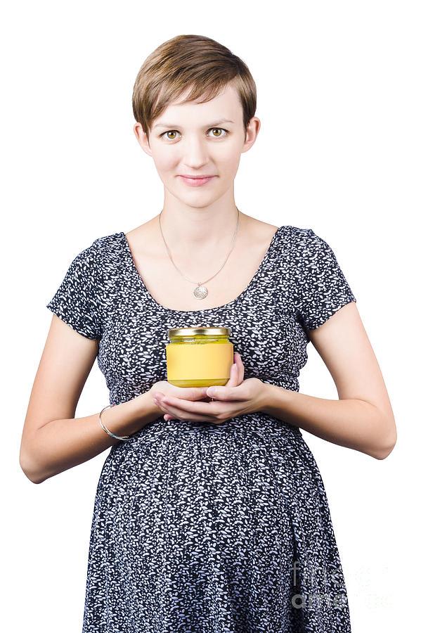 Holistic Naturopath Holding Jar Of Homemade Spread Photograph
