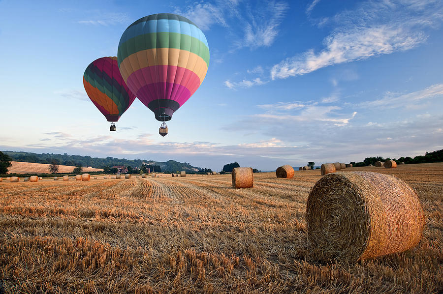 Landscape Photograph - Hot Air Balloons Over Hay Bales Sunset Landscape by Matthew Gibson