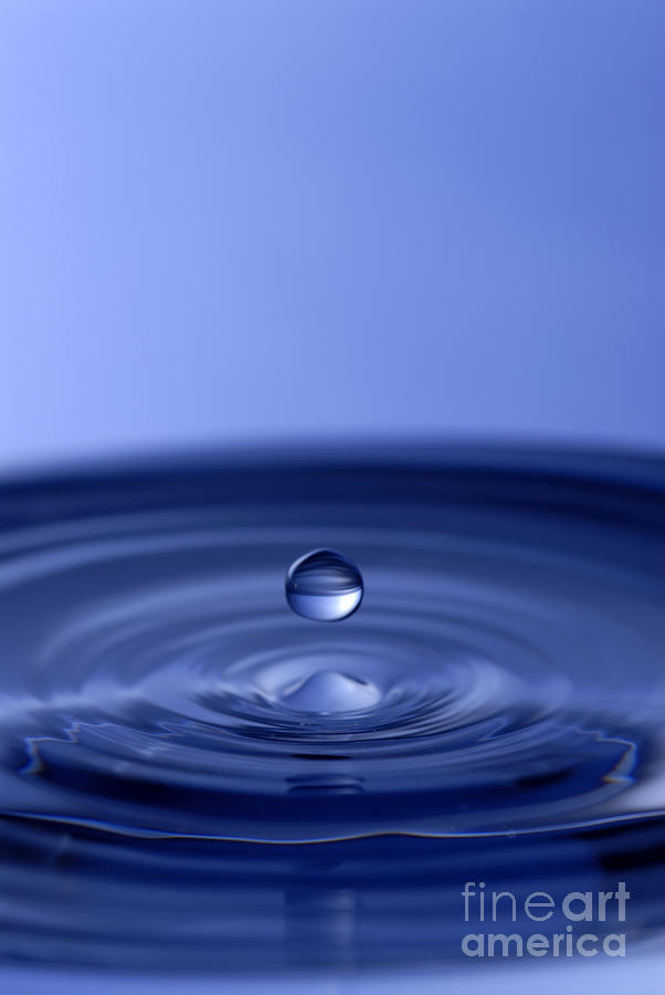 Hovering Blue Water Drop Photograph