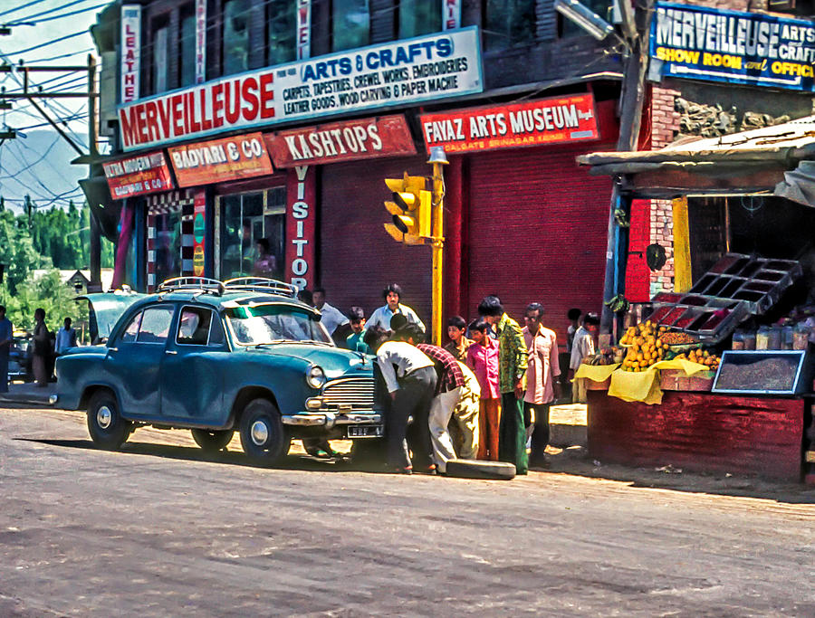 India Photograph - How To Change A Tire by Steve Harrington