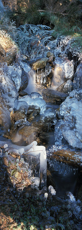 Ice Is Encrusting A Waterfall Photograph
