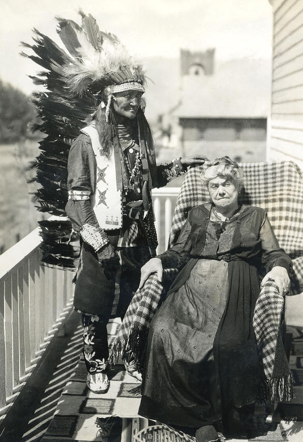 Indian Chief And Woman Photograph by Charles Beeler