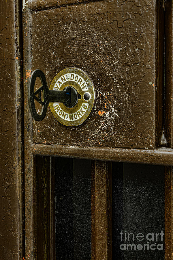 Jail Cell Door Lock  And Key Close Up Photograph