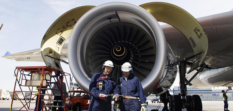 Airplane-mechanics Photograph - Jet Engine And Air Mechanics by Christian Lagereek