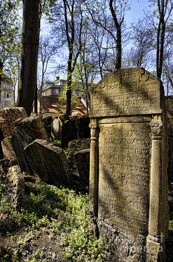 This Is The Cemetery In The Jewish Quarter Of Prague That Has Many Graves Crowded Into A Very Small Space. When People Say A Prayer By One Of The Graves They Place A Small Stone On The Top Of The Grave Or Tuck A Paper Prayer Into Crevices Near The Grave. Jews Must Not Destroy Jewish Graves And In Particular It Is Not Allowed To Remove The Tombstone. This Meant That When The Cemetery Ran Out Of Space And Purchasing Extra Land Was Impossible Photograph - Jewish Cemetery by Brenda Kean