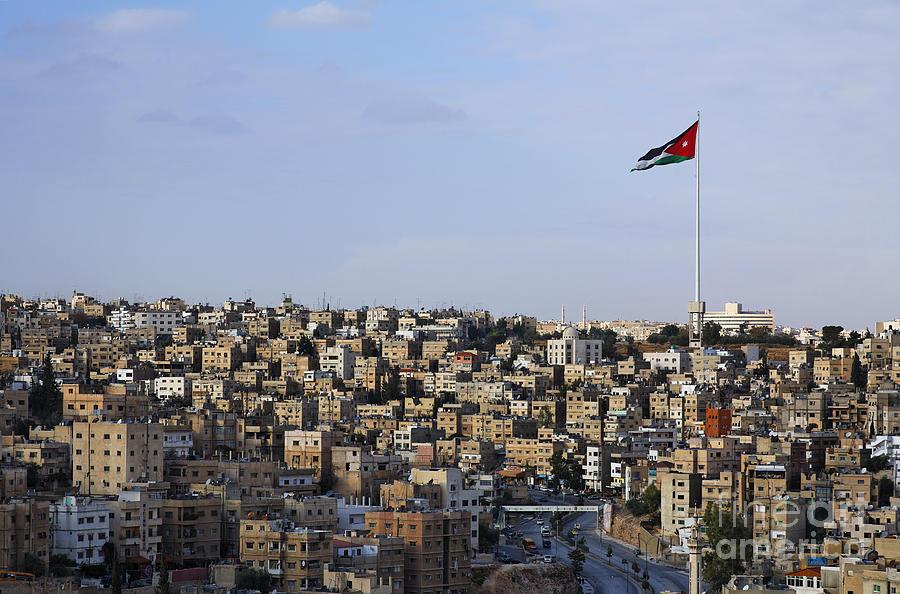 Amman Photograph - Jordanian Flag Flying Over The City Of Amman Jordan by Robert Preston
