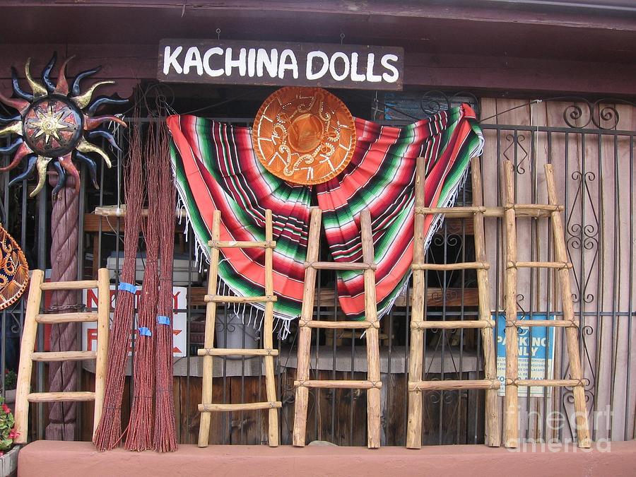 http://images.fineartamerica.com/images-medium-large-5/kachina-dolls-local-store-front-dora-sofia-caputo.jpg
