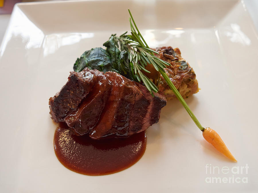Kobe Beef With Spring Spinach And A Wild Mushroom Bread Pudding Photograph