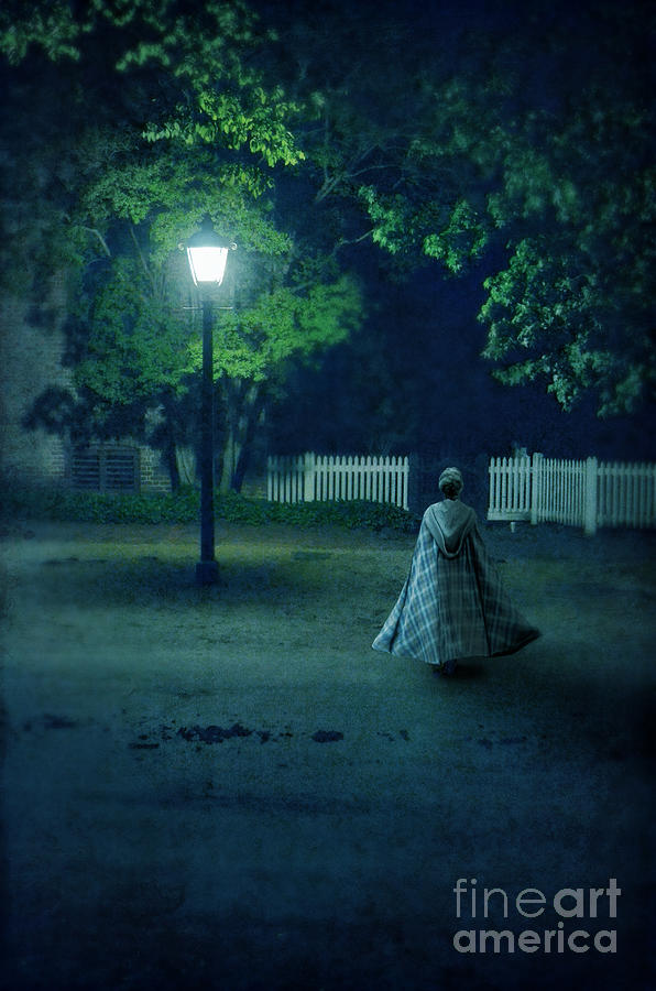 Lady In Vintage Clothing Walking By Lamplight Photograph