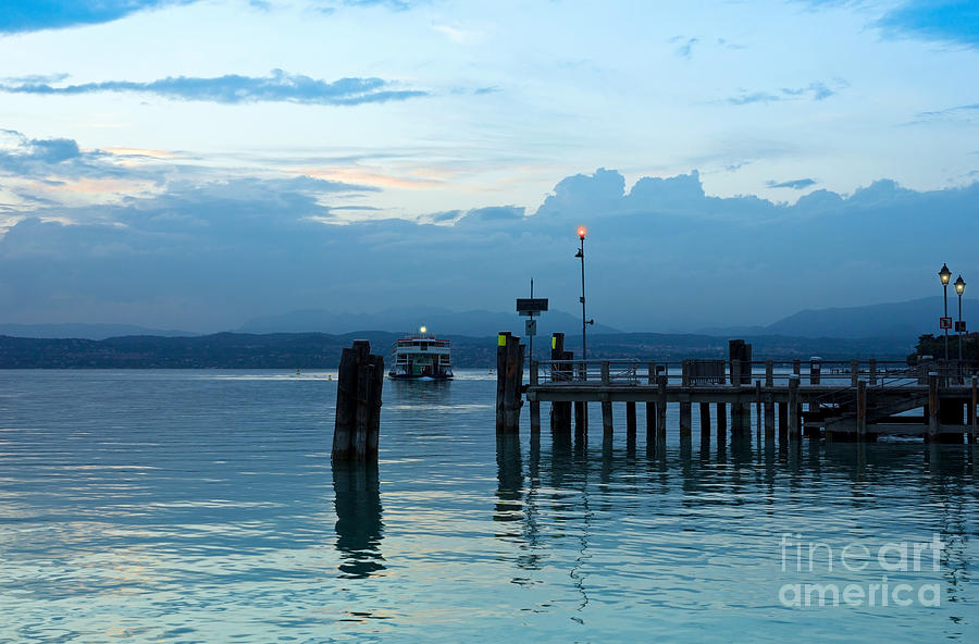 Sky Photograph - Lake Garda Pier And The Last Ferry For The Day by Kiril Stanchev