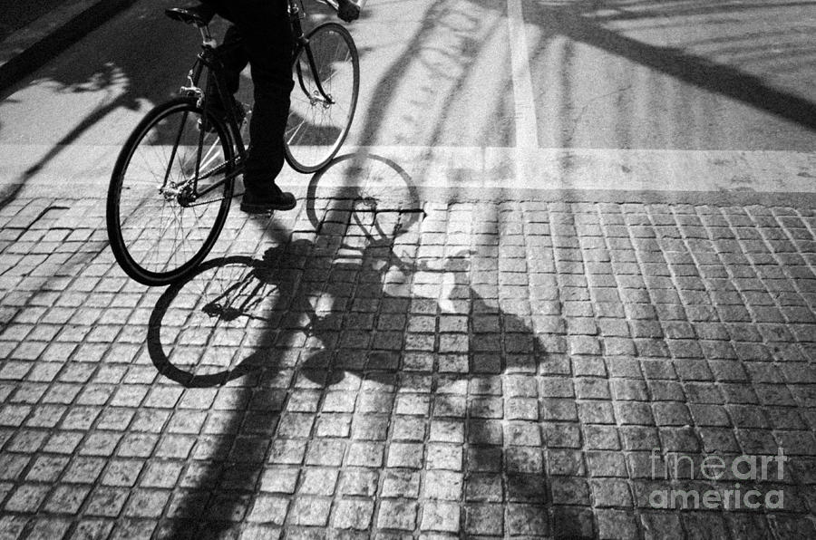 Light And Shadow Of A Man Ride The Bicycle Photograph