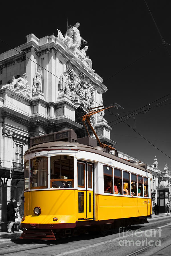 Lisbons Typical Yellow Tram In Commerce Square Photograph