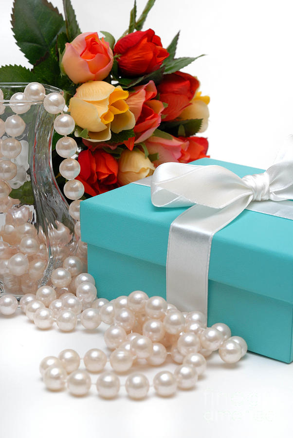 Little Blue Gift Box With Pearls And Flowers Photograph