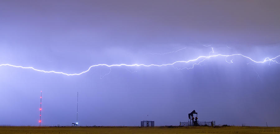 Long Lightning Bolt Strike Across Oil Well Country Sky Photograph