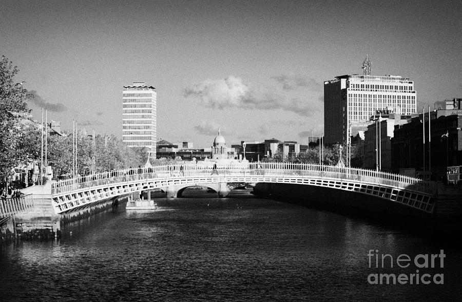 Looking Down The Liffey Towards The Hapenny Ha Penny Bridge Over The River Liffey In Dublin Photograph  - Looking Down The Liffey Towards The Hapenny Ha Penny Bridge Over The River Liffey In Dublin Fine Art Print