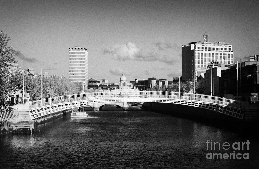 Dublin Photograph - Looking Down The Liffey Towards The Hapenny Ha Penny Bridge Over The River Liffey In Dublin by Joe Fox