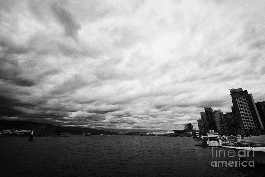 looking out from coal harbour into Vancouver Harbour on an overcast cloudy day BC Canada Photograph