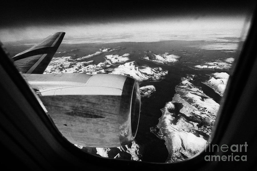 Looking Photograph - Looking Out Of Aircraft Window Over Snow Covered Fjords And Coastline Of Norway Europe by Joe Fox