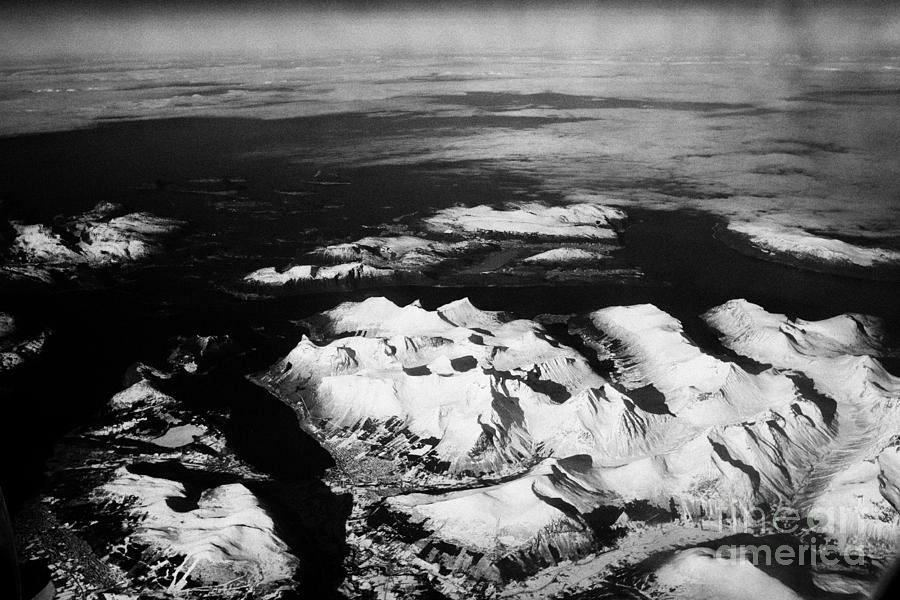 Looking Out Of Aircraft Window Over Snow Covered Fjords And Coastline Of Norway Northern Europe Photograph